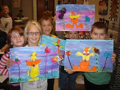 Loraxes, painted backgrounds, Loraxes colored with markers, pipe cleaners with tissue paper for Trees, and fringe cut grass. Jamestown Elementary Art Blog