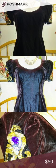 Vintage Nordstrom collection dress Beautiful and unique vintage Nordstrom Collection velvet dress. Color changing from burgundy to Black back from black to burgundy. Size 4. More beautiful in person. Don't let this one pass you up. Message me for more details Discounters. Thank you for looking and I love offers Nordstrom Dresses