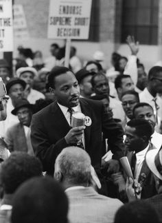 Not originally published in LIFE. During the 1960 Republican National Convention in Chicago, Martin Luther King Jr. leads a demonstration calling for a strong Civil Rights plank in the GOP campaign platform. (Francis Miller—Time & Life Pictures/Getty Images) See more:  http://ti.me/PnMzCU