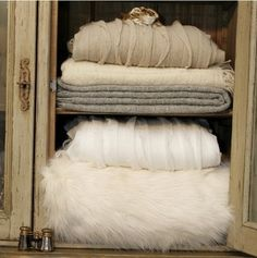 Love the contrast between the tethered cabinet & soft throws