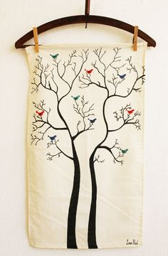 Hand decorated Tea Towels.  Could also be done with pillow cases.  Basically just draw on the fabric with fabric markers.
