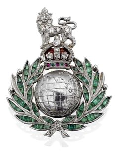 Multi-gem set Royal Marines sweetheart brooch The lion and coronet surmount set with single-cut diamonds, cabochon-cut rubies, cabochon-cut emeralds and with red enamel detail, the globe with detailed engraving and the laurel wreath set with calibré-cut emeralds and single-cut diamonds, length 35mm