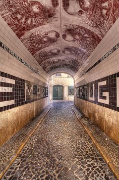 Túnel do Pátio do Tronco in Lisbon, Portugal. Looks like a maze that you can just get lost in forever.