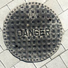 Danger Manhole Cover Doormat  Original Photography by Vernakular