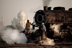 Steam Train: Agra, Uttar Pradesh, India, 1983. Photo by Steve McCurry This photo recorded the contrast between technology and the Taj Mahal, visible in the background. The steam engine, once an important symbol of Indian national culture, is now a thing of the past. McCurry's photograph captures a lost moment in culture. Even the tracks near the Taj Mahal have now been removed. #Trains