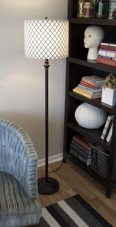 I recently bought a set of five cheap lamps from a big box store. The price was right, but I wasn't loving the tapered shades. Purchase five new drum shades? Not on my budget. Then it hit me. A tapered shade is pretty much half a drum shade, isn't it? Chop off the top ring, extend the spokes, flip it upside down, and for 3 bucks plus the cost of fabric, you have a drum shade! You can do it, too - jump below for the step-by-step: