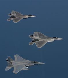 22. Two USAF F/A-22 (F-22A) Raptor Stealth Fighter Jets and A USAF F-15 Eagle Flying In Formation During A Training Sortie, August 12, 2005, Off the Coast of Langley Air Force Base (AFB), Commonwealth of Virginia, USA. Photo Credit: Tech. Sgt. Ben Bloke, United States Air Force; Defense Visual Information (DVI, http://www.DefenseImagery.mil, 050812-F-YL744-036) and United States Air Force (USAF, http://www.af.mil), United States Department of Defense (DoD, http://www.DefenseLink.mil or ...