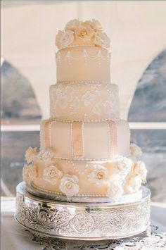 This is an ivory wedding cake I did for a sorority sister's wedding.  Finally got the photos from the photographer-yay!  All handcrafted roses and royal icing piped for the brushed embroidery and used for the crown border and details.  TFL!
