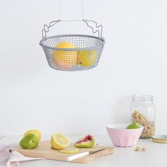 Add pop of color and decorate your kitchen with a cool, handmade hanging fruit basket.
