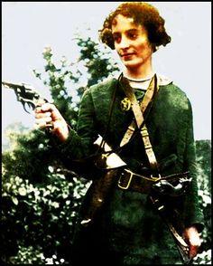 Cumann na mBann member, Mollie Gill, brandishing a pistol.