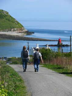 Isle of Anglesey Coastal Path walkers going down to Penmon Point by Puffin Island. I love Anglesey. It's one of my favorite places on earth.