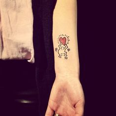 Small Keith Haring tattoo by Grain.