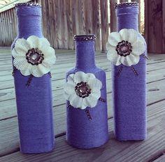 purple yarn wrapped bottles