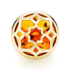 Paloma's Zellige ring in 18k gold with amber.
