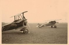 Fokker DR 1 with Fokker DVII, Germany's principal 1918 fighters, with the former largely superceded by the war's end in November.