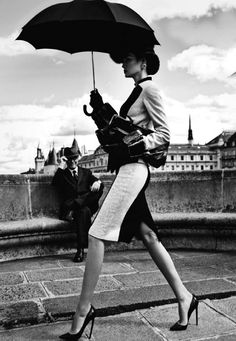 Black and white vintage UK, woman and umbrella