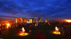 Dramatic: Fires light up the ancient stones at Stonehenge near Salisbury, Wiltshire as French artists Compagnie Carabosse present Fire Garden for the Salisbury International Arts Festival