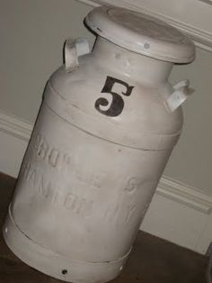 Old milk jugs can be refurbished and can be used for umbrella stands or holding a collection of old walking sticks.