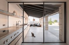 With Sky-Frame we always would like to create a seamless transition between indoors and outdoors. A perfect example is the superb Finca Sonrisa on the sunshine island of Mallorca, where the kitchen goes all the way out onto the terrace.  📐Holzrausch Planung GmbH in cooperation with Lissy Hartl 📷@oliverjaist 🔧@exceptionalwindows  #skyframe #aviewnotawindow #frameless #doors #windows #swiss #quality #design #architecture #mallorca #architecturephotography #terrace #indooroutdoorliving Sliding Windows, Sliding Doors, Küchen Design, House Design, Seamless Transition, Indoor Outdoor Living, Exterior, Sky, Building
