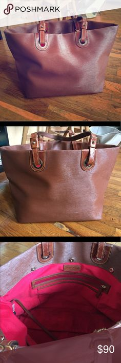 Authentic Dooney&Bourke Leather Tote Bag Beautiful Dooney & Bourke leather tote bag. Some discoloration in inside of bag. I've gotten some out but ran out of Oxi Clean. Should be easy to get out. Offers will be considered. Dooney & Bourke Bags Totes