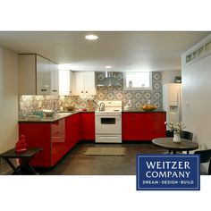 The combination of these bold colors and this beautiful tile come together wonderfully in this Weitzer Company basement ADU kitchen.  #interiordesign #interiordesigner #adu #adubasement #cementfloors #basementremodel #redkitchen #interior #interiordesign #interiors #kitchen #kitchendesign #kitchenremodel #kitchens #pdxkitchen #smallkitchen #basement #basementremodel #basements #loveyourbasement #backsplash #beautifulbacksplash #tile