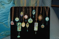 More resin necklaces - handpainted backgrounds and bezels.  Real starfish, sea horses and sand dollars.  Triple pour of Ice Resin.