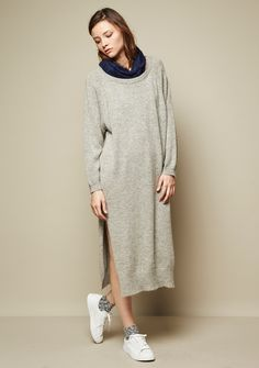 """Midi-length, round neck sweater dress with side slits. Relaxed fit overall. Long sleeves. Ribbing at neck, sleeve opening, and hemline.          • Contents : 5% Wool, 5% Angora, 58% Acrylic, 32% Nylon        • Dry clean only, do not wash        • Imported, South Korea     MEASUREMENTS 
