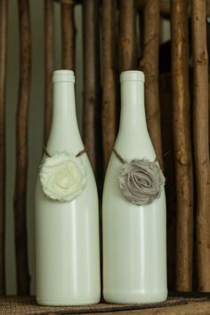 Simple...paint an old wine bottle and drape with silk flowers.  #crafts #winebottlecrafts