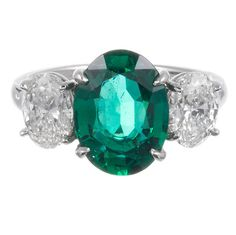 3.01 Carat Oval Emerald Diamond Three Stone Ring   From a unique collection of vintage three-stone rings at https://www.1stdibs.com/jewelry/rings/three-stone-rings/