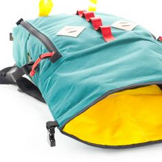 topo designs: roll top backpack