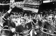 No team in NHL history has raised more Cups than the Montreal Canadiens, including this one in 1978 held up by Larry Robinson, Yvan Cournoyer and Guy Lafleur. Click through to see a history of the Montreal Canadiens vs. the Vancouver Canucks. Montreal Canadiens, Hockey Games, Hockey Players, Ice Hockey, Stanley Cup Playoffs, Stanley Cup Finals, Stanley Cup Trophy, Nfl Highlights, Hockey Boards