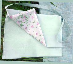 Le+Kit+coupé Pochette soie sauvage parme, doublée voile de coton imprimé fleurs. Prix 19 € sur le site les-fees.fr