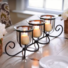 In the market for a centerpiece that will wow your guests? Shop Kirkland's Metal 3-Candle Table Runner and add it to your dining room table.