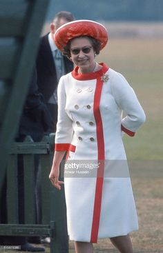 Seventies Chic -- Proving her penchant for contrasting hems once again, the Queen sported a cool white-and-red look complete with a matching hat to attend a polo match in Windsor, England. God Save The Queen, Hm The Queen, Royal Queen, Her Majesty The Queen, Princess Elizabeth, Queen Elizabeth Ii, Princess Kate, Norman Hartnell, Prinz Philip