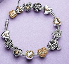 PANDORA Two Tone Bracelet with Gorgeous Heart Theme..........
