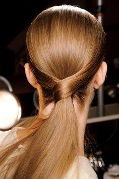 Very sleek Twist & wrapped low ponytail...x