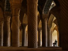 A worker inside Vakil Mosque, Shiraz. The mosque now serves as a tourist attraction but sees only a trickle of visitors. Although tourism is on the increase, western tourists still make up only 10% of the total. One tourist guide said westerners are scared away by the bloodcurdling rhetoric of a government completely out of touch with ordinary Iranians. (Amos Chapple)