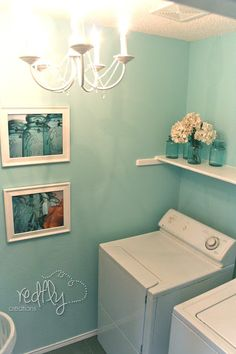 Cute laundry room with Rivers Edge by Behr paint color. Love the lighting. I'd spend all day in this laundry room. I just want those photos! LOVE THE BALL JAR PHOTOS Laundry Room Storage, Laundry Rooms, Small Laundry, Laundry Area, Laundry Closet, Bathroom Storage, Laundry Room Inspiration, Ball Jars, Room Paint