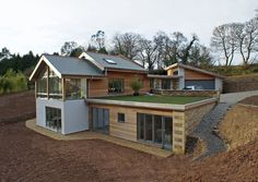 Contemporary Part Earth Sheltered Split Level House, Truro, CornwallSuper insulated timber frame sustainable build utilising recycled insulation, breathable construction and natural materials.  Passive solar heating, solar thermal and photovoltaic collectors to generate electricity.  Underground bedrooms with thermal mass and green roofs.  The house has been designed to minimise its impact upon the landscape and environment.