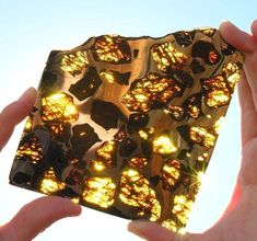 The beautiful and mysterious Fukang meteorite. Within the rock, translucent golden crystals of a mineral called olivine gleamed among a silvery honeycomb of nickel-iron. Minerals And Gemstones, Rocks And Minerals, Iron Meteorite, Beautiful Rocks, Beautiful Things, Stunningly Beautiful, Beautiful Images, Mineral Stone, Rocks And Gems