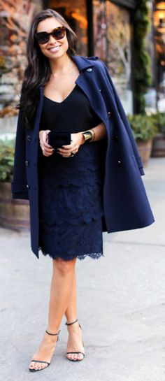 Lace will always be the classic style of choice for achieving elegance and grace in an outfit. Kat Tanita wears a tiered navy midi skirt with a simple black V neck tee and a matching double breasted over coat. We love this look!  Skirt: Caroline Issa, Heels: Stuart Weitzman, Coat: Tory Burch, Top: Aritzia.