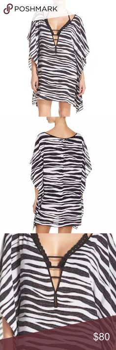 NWT VIX by Paula Hermanny Kaftan NWT.  Resort season is coming and what better way to lounge by the pool then wearing this sexy back and white zebra print kaftan. Vix by Paula Hermanny Swim Coverups