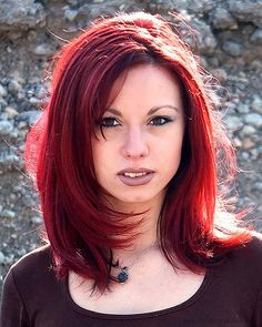 layered red and black hair | Young Woman in Dark Red Sexy Hair Color with Medium Length Style ...