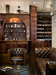 chesterfield like in a library or winery setting