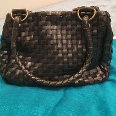 Nine West bronze brown purse Weaved Nine West bronze brown purse.. Very comfortable to carry...2 compartments... 2 zippers... Pocket for cell phone Nine West Bags Shoulder Bags