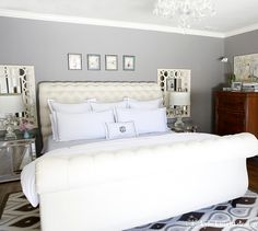 Jonathan Adler rug, Z Gallerie bed, Restoration Hardware linens and paint (Slate, matte finish), chandelier, Ballard Designs mirrors, Ballard Designs striped bench