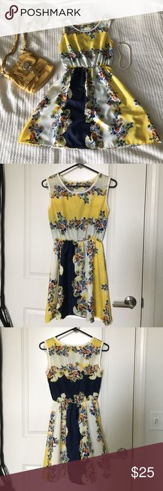 Beautiful boutique yellow and navy floral dress I bought this from a local boutique and just haven't worn! It's absolutely gorgeous, and very lightweight. Fits like a S/M. I typically wear a size 2 in dresses & it fits me perfectly, but has room to stretch as well. It is slightly see through, so would need either a slip or a bandeau with white shorts to be worn under. Perfect summer dress! Feel free to make an offer! Dresses