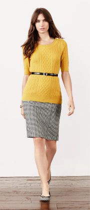 Yellow textured sweater-top and a nice skirt in black and white houndstooth.