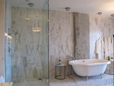 Marble like tile in master bath, seamless shower, and modern claw foot tub