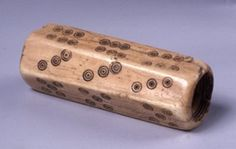 Bone hexagonal dice; it is grooved around inside edge at both ends as if for a screw. Greek & Roman Antiquities